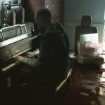 pastor plays piano in flooded home