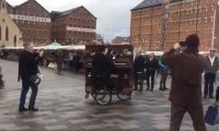 Man playing piano on bike in Gloucester